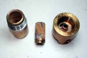 CFC 50 Series Brass Tee Filter after modified ASTM G-175 testing at 5000 psig oxygen.